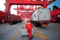 A worker at the Yangshan deep water port in the Shanghai free trade zone. Photo: Reuters