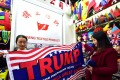 A shop assistant with a pro-Trump banner at the China Yiwu International Trade City. Photo: AFP