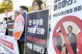 People stage a rally in Seoul against Japan-South Korea talks over the General Security of Military Information Agreement. Photo: Kyodo