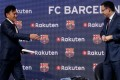 FC Barcelona's President Josep Maria Bartomeu (right) greets Rakuten's President and CEO Hiroshi Mikitani on Wednesday. Photo: Reuters