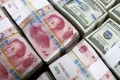 China's central bank on Thursday set the daily fixing 100 basis points, or 0.15 per cent weaker at 6.8692 to the US dollar, the lowest level since June 2008. Photo: Reuters