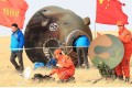 Technicians examine the Shenzhou-11 re-entry capsule in Inner Mongolia on Friday. Photo: Xinhua