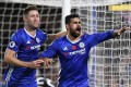Chelsea's Diego Costa (R) is congratulated by teammate Gary Cahill after scoring against Everton EPA/WILL OLIVER