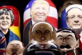 Matryoshka dolls bearing the faces of German Chancellor Angela Merkel, Donald Trump, French President Francois Hollande, Britain's Queen Elizabeth, Vladimir Lenin, Russian President Vladimir Putin and Josef Stalin are displayed at a souvenir shop in central Moscow. Photo: Reuters