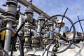 A worker checks the valves at Al-Sheiba oil refinery in the city of Basra, Iraq. Photo: Reuters