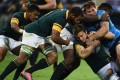 Italy's Tommaso Benvenuti fights for the ball with South Africa's Patrick Lambie as the Springboks go down 20-18. Photo: AFP