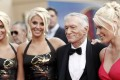 Identical twins Karissa and Kristina Shannon, Hugh Hefner and Crystal Harris arrive at the taping of the American Film Institute Life Achievement Awards in Culver City, Californiam in 2009. Photo: AP