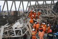 Rescuers work at the construction disaster site at the Fengcheng power plant in Yichun, Jiangxi province, on Thursday. Photo: Xinhua