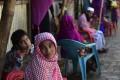 Myanmar Rohingya refugees look on in a refugee camp in Teknaf, in Bangladesh's Cox's Bazar. Photo: AFP