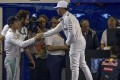 Mercedes teammates Nico Rosberg (left) and Lewis Hamilton shake hands after qualifying for the Abu Dhabi Grand Prix. Photo: EPA