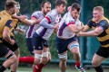 New HK Scottish flanker Josh Dowsing heads forward as Tigers lock Ben Featherstone attempts to tackle. Photos: SCMP Pictures