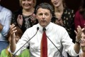 Italian Prime Minister Matteo Renzi addresses supporters during a rally calling for a 'Yes' vote to the upcoming constitutional reform referendum. Photo: AFP