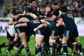 France's lock Julien Le Devedec (centre) vies in a scrum. Photo: AFP