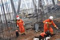 Rescue workers search through the remains of a collapsed platform in a cooling tower at the power station in Fengcheng. Photo: AFP