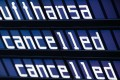 The words 'Lufthansa' and 'cancelled' on the display board at the airport in Munich, Germany. Photo: EPA