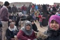 Syrian families are fleeing from various eastern districts of Aleppo. Photo: AFP