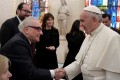 Pope Francis meets film director Martin Scorsese during a private audience at the Vatican.