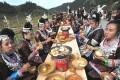 Dong women in Liping county enjoying their new year feast. Photo: Xinhua