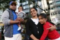 From left, Supun Thilina Kellapatha, his seven-month-old son Dinath, wife Nadeeka Dilrukshi Nonis and daughter Sethumdi, five. The family gave shelter to Edward Snowden during his time in the city in 2013. years old, poses for a picture in Wan Chai. Ajith who sheltered Snowden in Hong Kong. 02DEC16 SCMP / Photo: Jonathan Wong