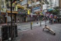 Ou Zhihang poses in February outside the bookstore in Hong Kong linked to the disappearance of booksellers. Photo: AFP
