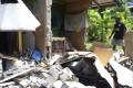 A damaged house in Kirakira, Solomon Islands. Photo: AP