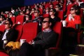 Moviegoes wear 3-D glasses at a theatre in Beijing. An average of 27 cinemas are being built each day in China. Photo: Bloomberg