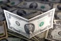 US dollar notes are seen in this picture illustration. Photo: Reuters