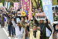People stage a rally in Nago in Japan's southernmost island prefecture of Okinawa following a crash-landing incident involving a US Marine Corps MV-22 Osprey tilt-rotor aircraft. Photo: Kyodo