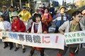 People stage a rally against the construction of a helipad near the US military's Northern Training Area in the village of Higashi. Photo: Kyodo