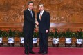 Leung Chun-ying (left) and Wang Yi meet in Beijing on Leung's first day of his final duty visit. Photo: ISD