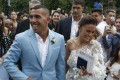 Carlos Tevez and his wife Vanesa Mansilla exit the church after their wedding in Buenos Aires. Photo: AP