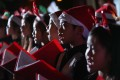 Children sing carols at the White Christmas Street Fair in Wan Chai, which is part of Operation Santa. Photo: Xiaomei Chen