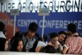 Job seekers at a recruitment fair for call centre agents in Manila. The rapid expansion of the Philippine BPO industry is giving young Filipinos the chance to find middle-class jobs that previously only existed outside the country. Photo: AFP