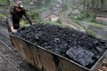 Chinese coal firms have struggled as the country's economic slowdown batters demand and Premier Li Keqiang vows to cut excess capacity in industry. Photo: AP