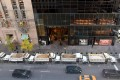 A protective barrier of sand-filled Sanitation Department trucks is parked in front of Trump Tower in Manhattan on November 10, as a counter-terror measure. The same tactic will protect revellers in Tines Square on New Year's Eve. Photo: AFP