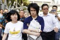 Teen blogger Amos Yee leaves with his parents after his sentencing from the State Court in Singapore. Photo: Reuters