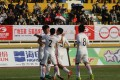 Tan Chun-lok celebrates with teammates after scoring for Hong Kong. Photo: HKFA