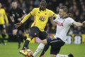 Tottenham's Kevin Wimmer (right) blocks a shot by Watford's Abdoulaye Doucoure. Photo: AP