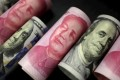 Onshore yuan fell against the US dollar on the first trading day of 2017. Photo: Reuters
