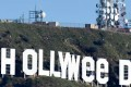 "The famous Hollywood sign reads ""Hollyweed"" after it was vandalized, January 1, 2017. Police said unidentified thrill-seekers had climbed up and arranged tarps over the two letter ""O's"" to make them look like ""E's."" Photo: AFP"