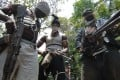 Masked Ateke Tom militants stand with guns at their camp, in Okrika, Rivers State, Nigeria. Picture: AFP