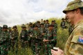 An Australian soldier briefs Indonesian personnel during joint drills. Photo: Reuters
