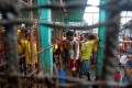 Inmates gather inside the Kidapawan prison following the escape of more than 150 inmates. Photo: Reuters