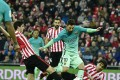 Barcelona's Lionel Messi, center, tries to control the ball between Athletic Bilbao's Xabier Etxeita and Mikel San Jose, right, during the Spanish Copa del Rey round of 16 first leg soccer match. Photo: AP