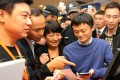 Alibaba's Jack Ma Yun (second, right) is accompanied by Intime Retail Group chairman Shen Guojun (second left) on November 16, 2013. Photo: Xinhua
