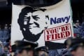 Cadets from the US Military Academy fly a banner depicting Donald Trump prior to the game between the Navy Midshipmen and the Army Black Nights at M&T Bank Stadium in Baltimore, Maryland. Photo: AFP