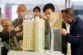 Potential home buyers review the choices on offer under the Green Form Ownership Pilot Scheme in Lok Fu on Thursday. Photo: Edward Wong