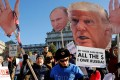 FILE PHOTO: People protest against US President-elect Donald Trump as electors gather to cast their votes for US president at the Pennsylvania State Capitol in Harrisburg, Pennsylvania, US December 19, 2016. REUTERS/Jonathan Ernst/File photo