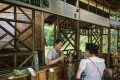 A tourist buys bamboo liqueur in the Yibin bamboo forest. Photo: AFP