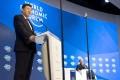 Chinese President Xi Jinping addresses the World Economic Forum on Tuesday. Photo: EPA